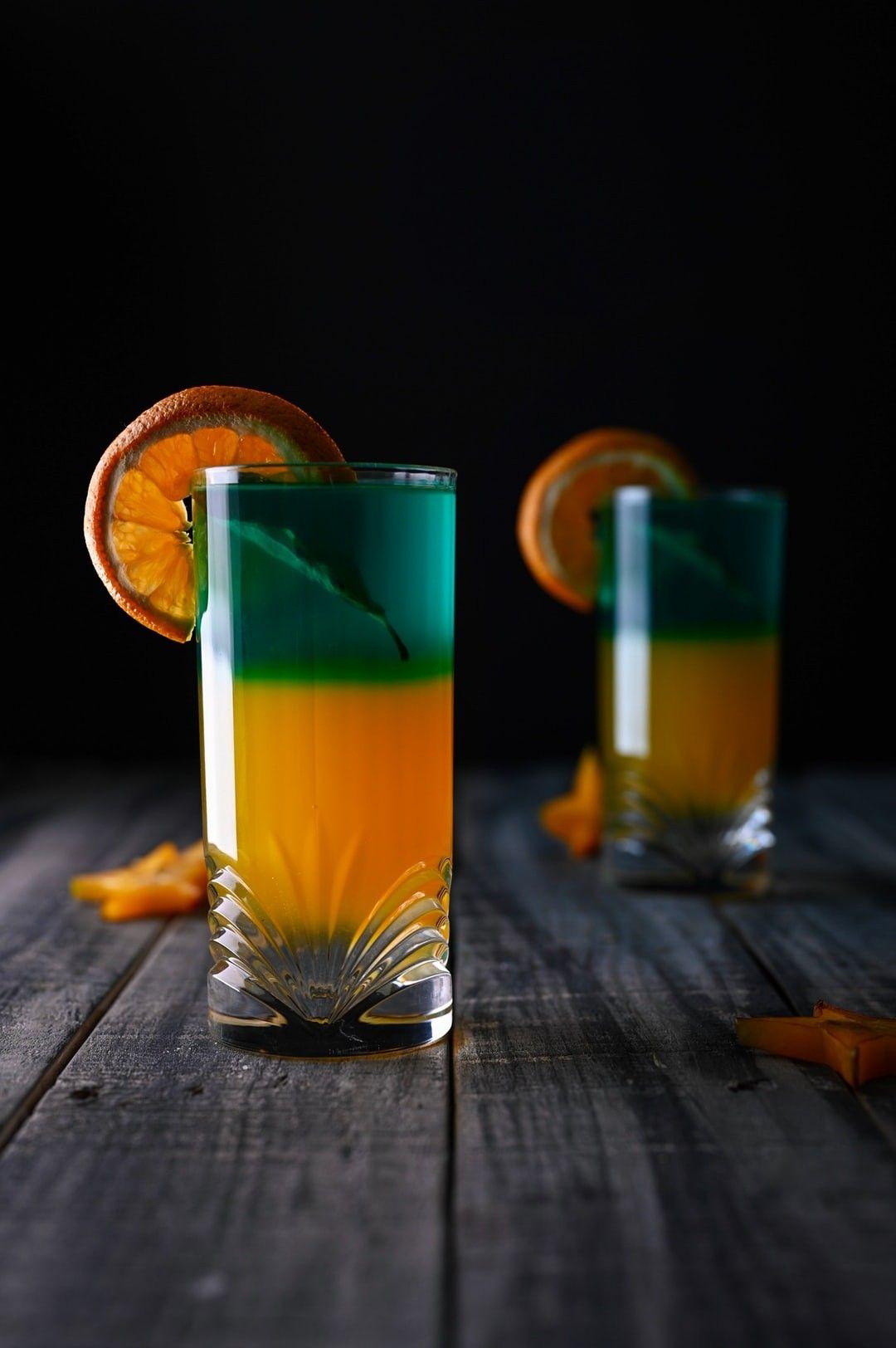 Orange Juice With Sliced Orange On Tip Of Glass Hd