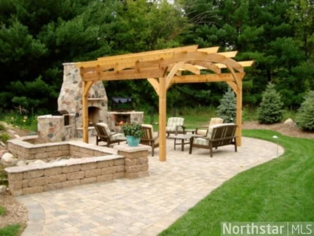 Fabuous outdoor living space with pergola koi pond for Garden pond grills