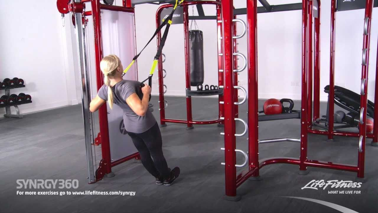 Try This At The Plex On Our Synergy 360 System Back Row Grasp Handles With Arms Extended While Maintaining A Straight Torso Trx Training Fit Life Back Row