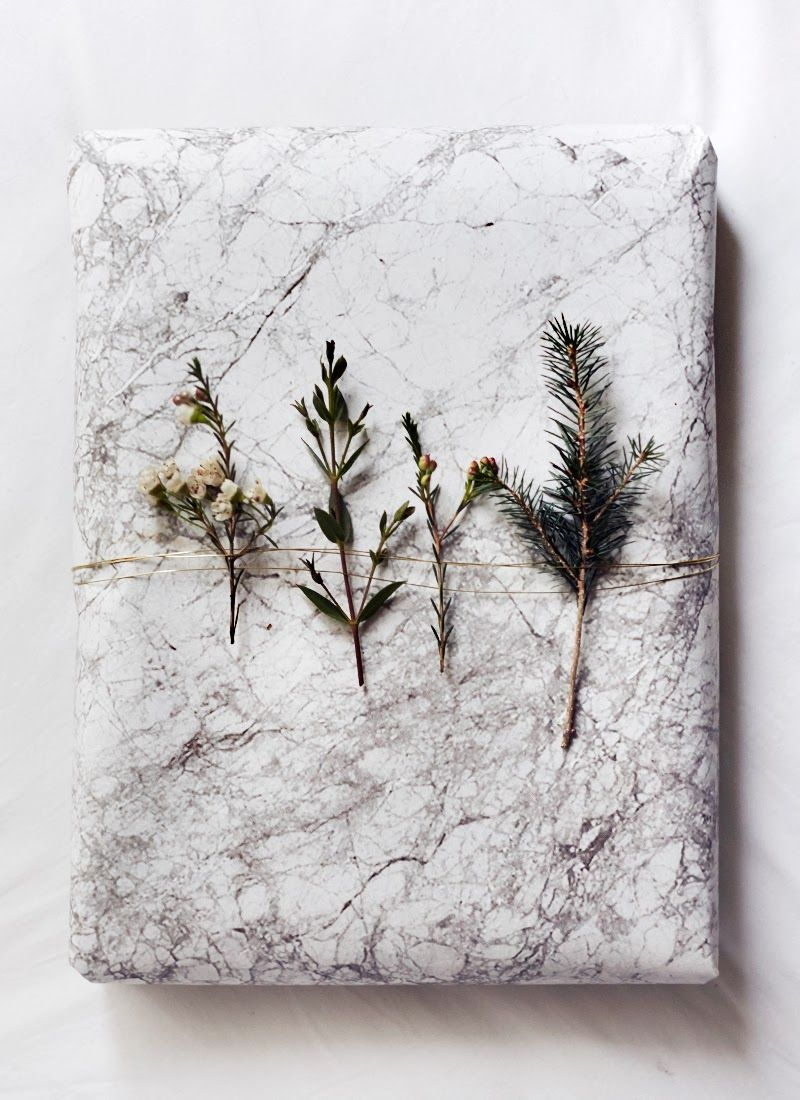 Marble paper, thin gold wire and plant clippings. Nice!