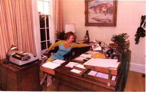 Rose Mary Woods, Nixon's Secretary, demonstrating how she might of accidentally erased a key 18 and a half minute conversation about Watergate.