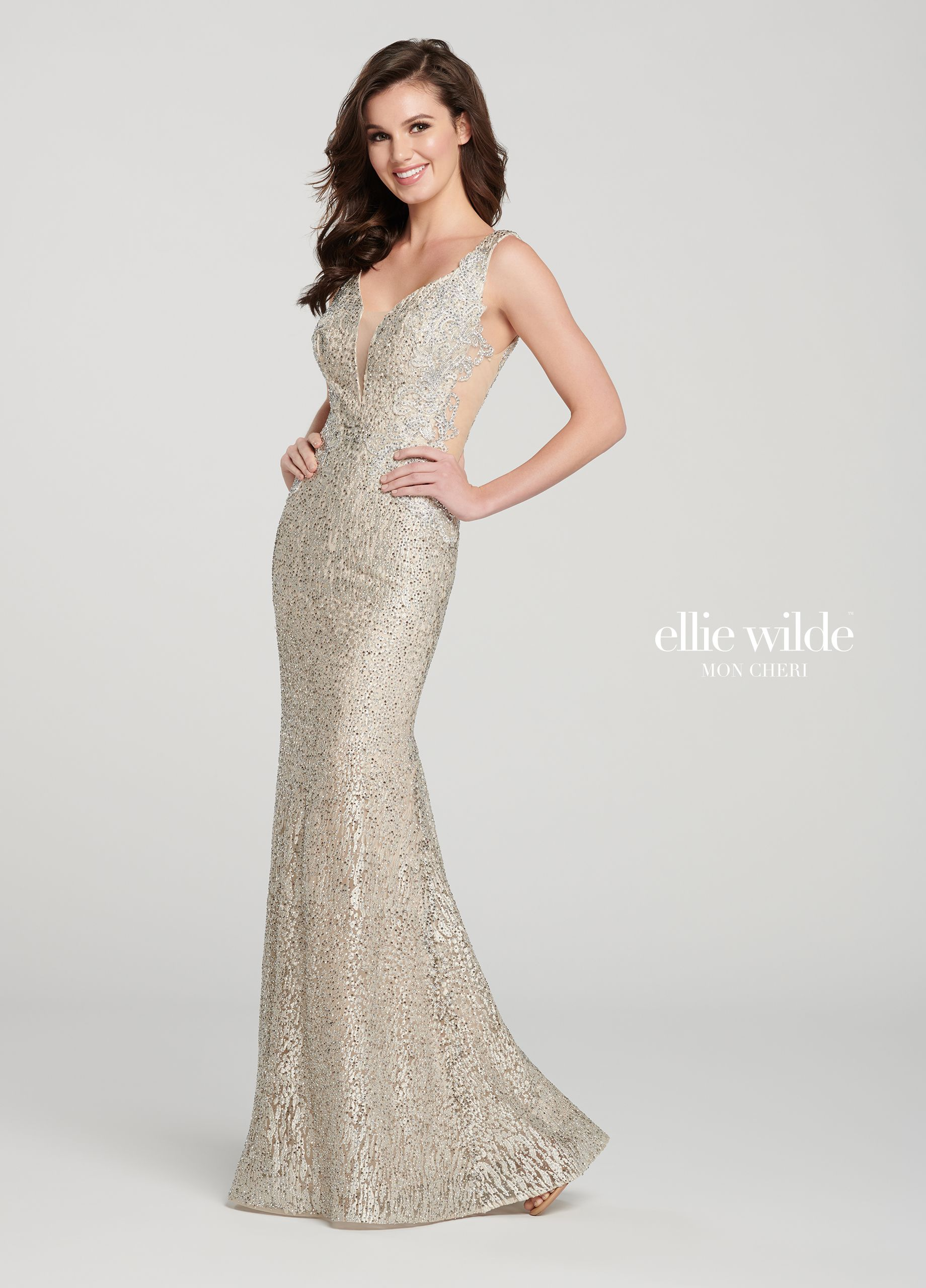 7b40580932 Ellie Wilde EW119080 - This enticing sleeveless embroidered fit and flare  gown with allover stone accents offers a deep plunging V-neck with an  illusion ...