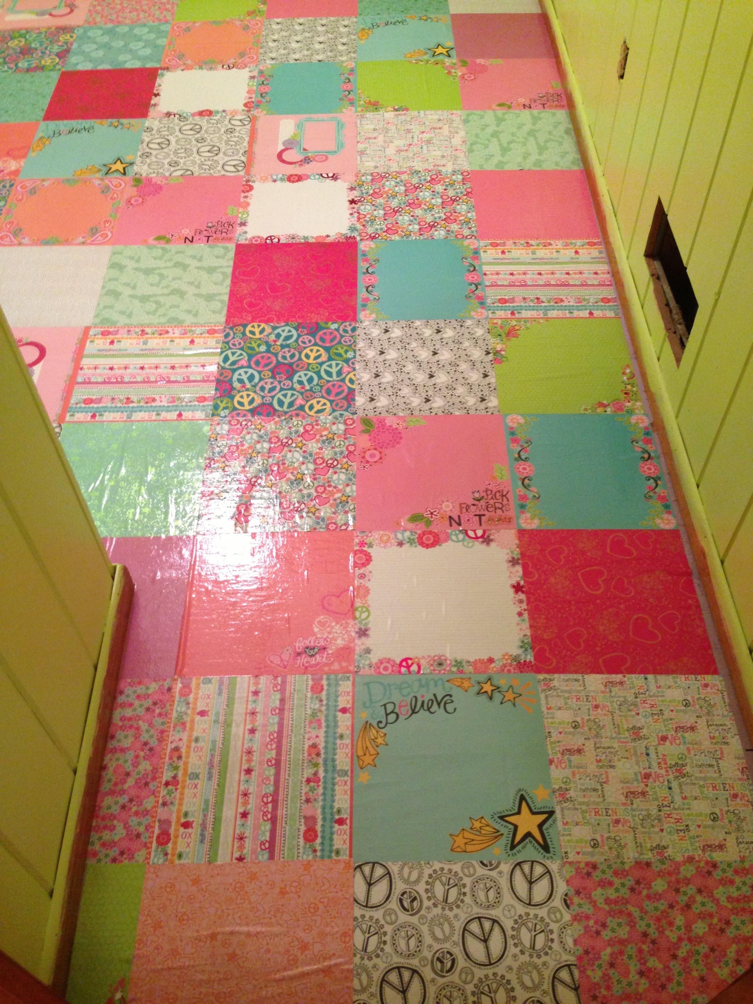 Scrapbooking paper floor! Decoupaged and Varathaned for