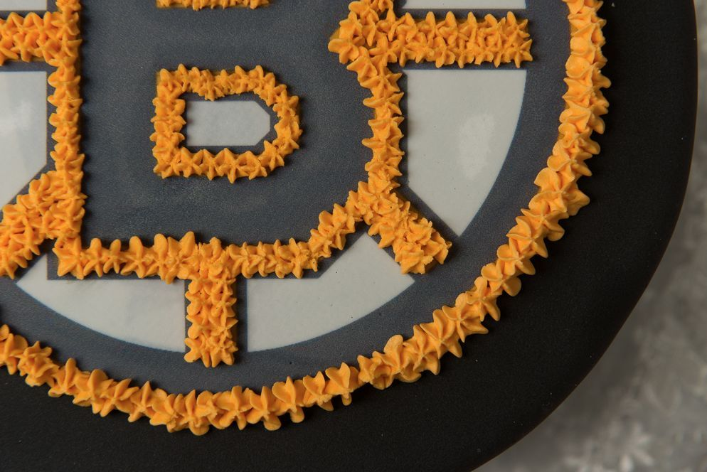 Boston Bruins Hockey Puck Cake