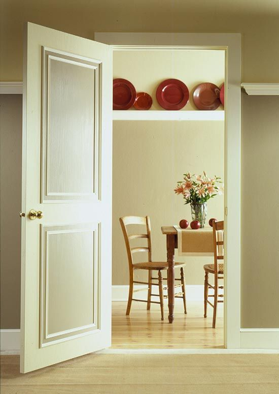 DIY:  How to Upgrade a Hollow Core Door - if your interior doors are blah, this tutorial will show you how to give them pizzazz by adding inexpensive moulding, caulk and paint - via BHG