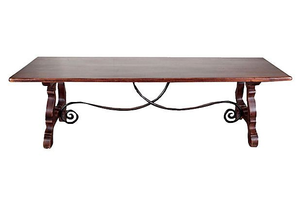 Spanish Trestle Table on OneKingsLane.com described by Negrel Antiques Trestle table from Spain made of oak with a scrolled iron stretcher. Can accommodate ten guests. Floor to apron,