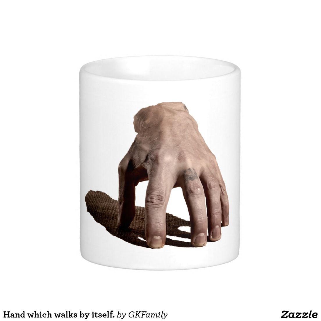 Hand which walks by itself. classic white coffee mug