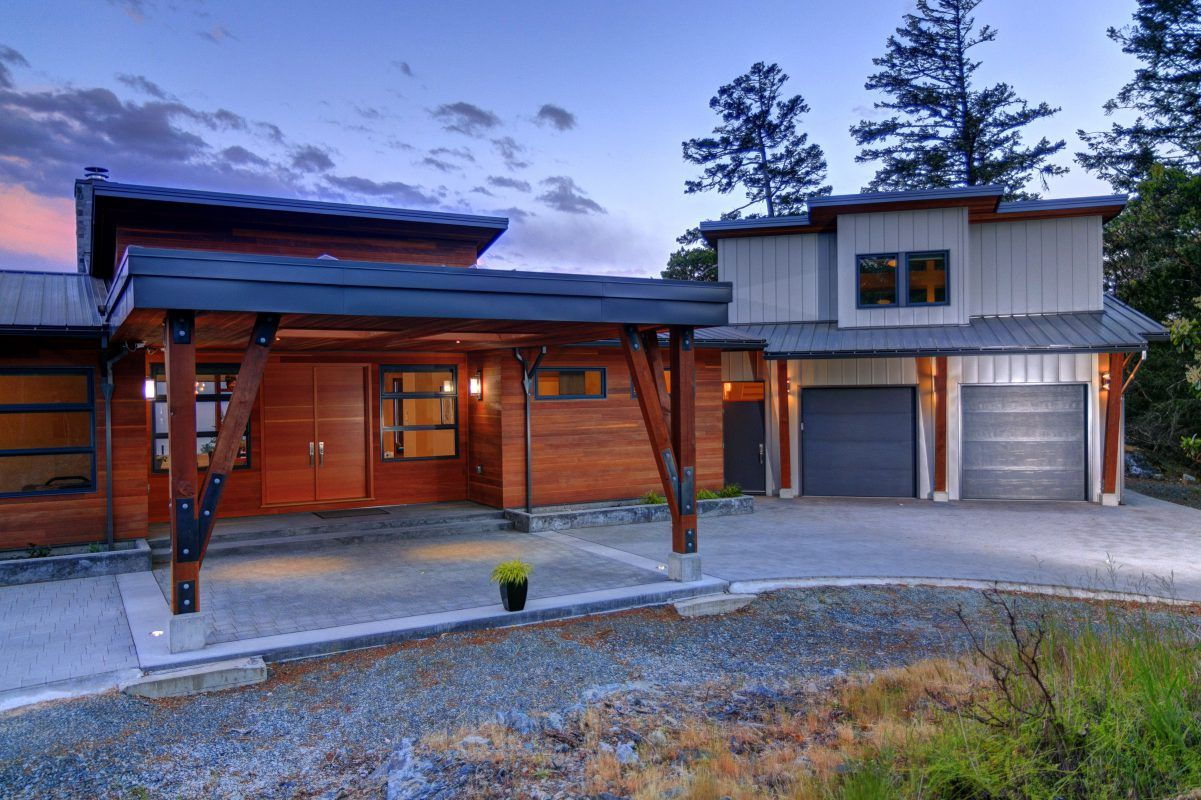 The portico is distinctive from metal clad exterior of the