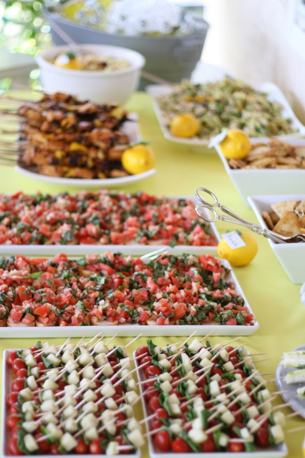 bridal shower food table yellow small tomotos and cheese on a tooth pick