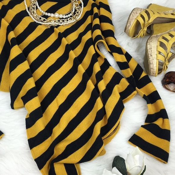 Yellow Stripped Top Black and yellow striped top. Colors are very vibrant, one shoulder shown when worn. Front and back have the same pattern. Very Stylish.  Content:  100%  Acrylic   ▪️No Damages ▪️Smoke/Pet free No Trades  ▪️Like the Item not the Price? Make an Offer with the button below   ❣Happy Poshing Tops