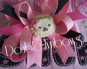 So cute and perfect for Easter!    Polka dots and a faux lolly center!    This mini bow is the same design as my larger bows but without the base bow.    The bow is attatched to an alligator clip and can be worn alone or with a crochet head bands.    Listing is for the bow only if you require a crochet headband please contact me