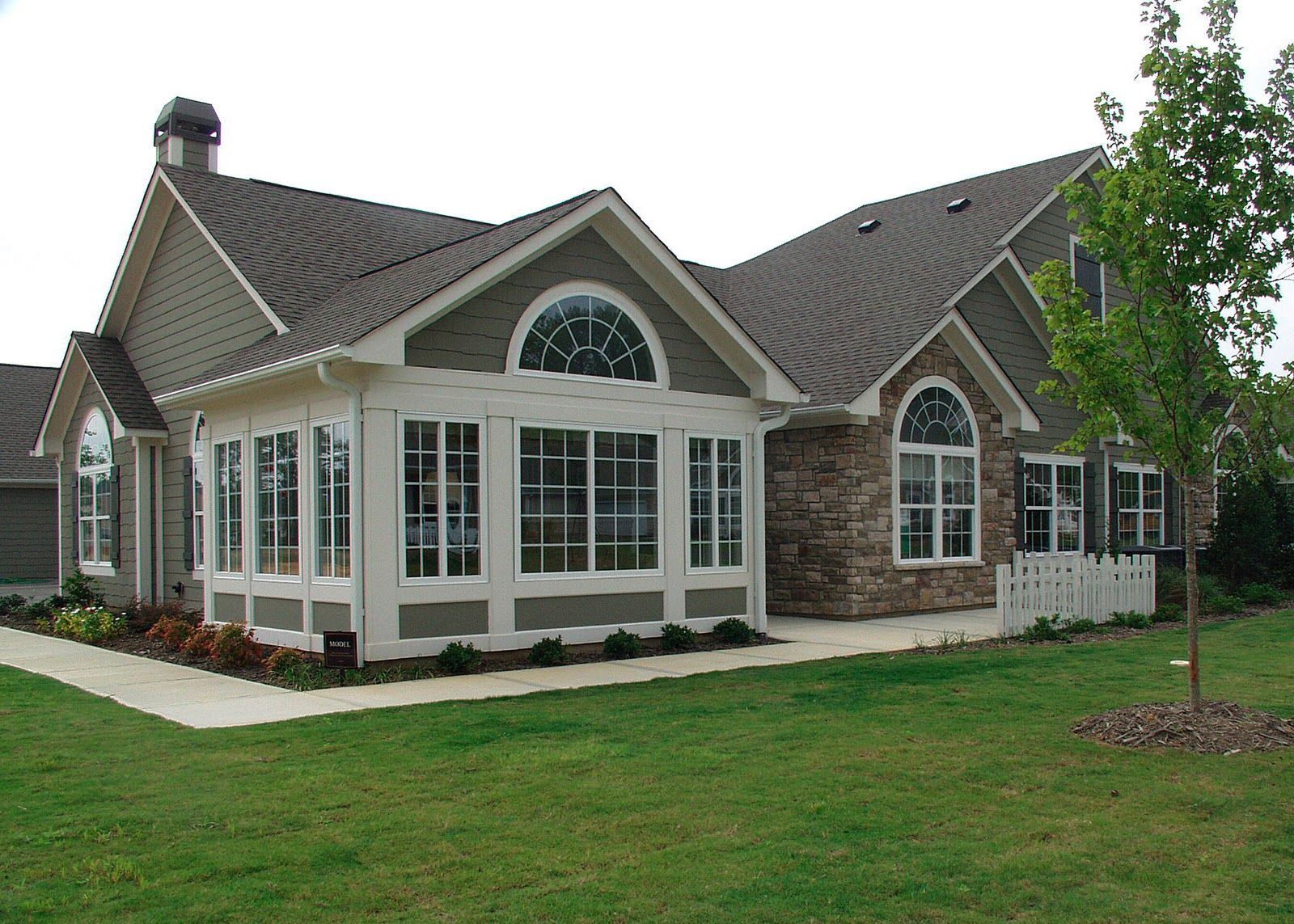 One story house with tall entrance attached garage are for New construction ranch style homes in illinois