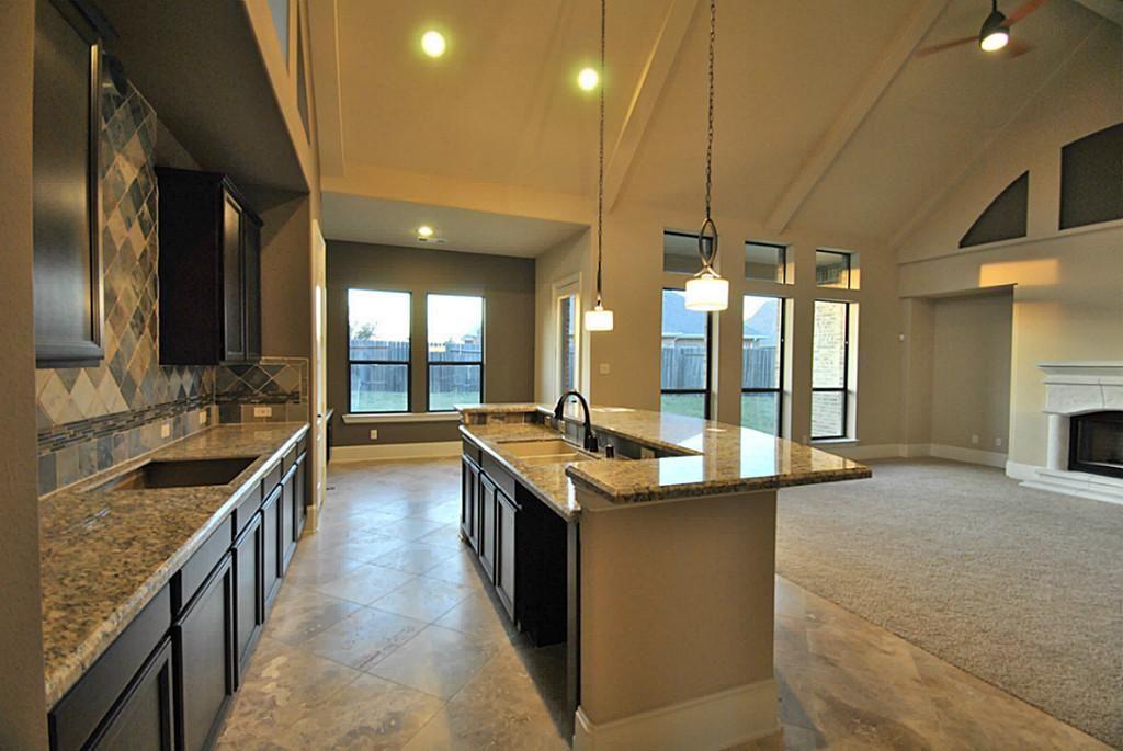 Gourmet Kitchen with Upgrade Large travertine Stone Tile ...