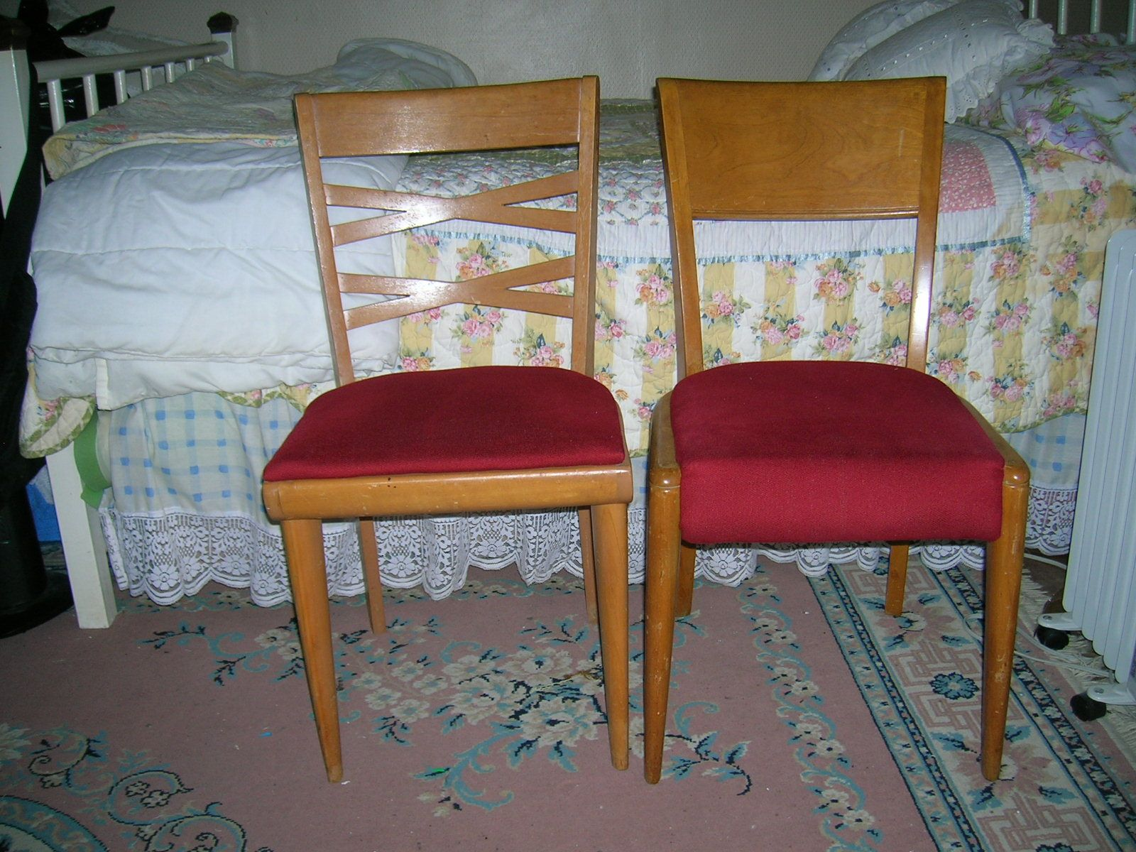 These are my Heywood Wakefield chairs, the left has the logo on the chair, after research the right chair is probably an earlier chair that had the paper tag.  Both are tight and sturdy chairs.  I will give to my girls, or sell to someone who will love them.