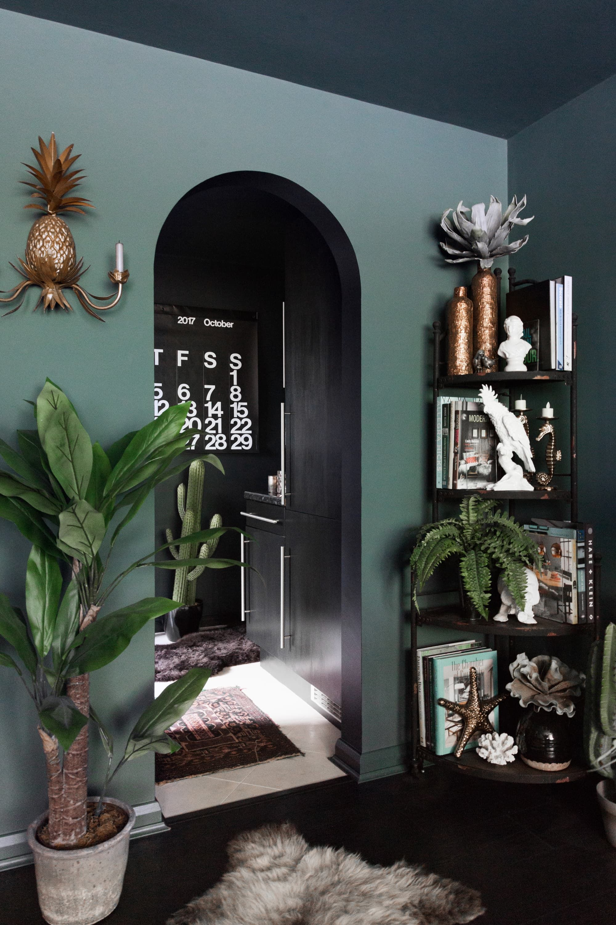 A Dramatic, Maximalist London Flat Is Dark, Eclectic, and
