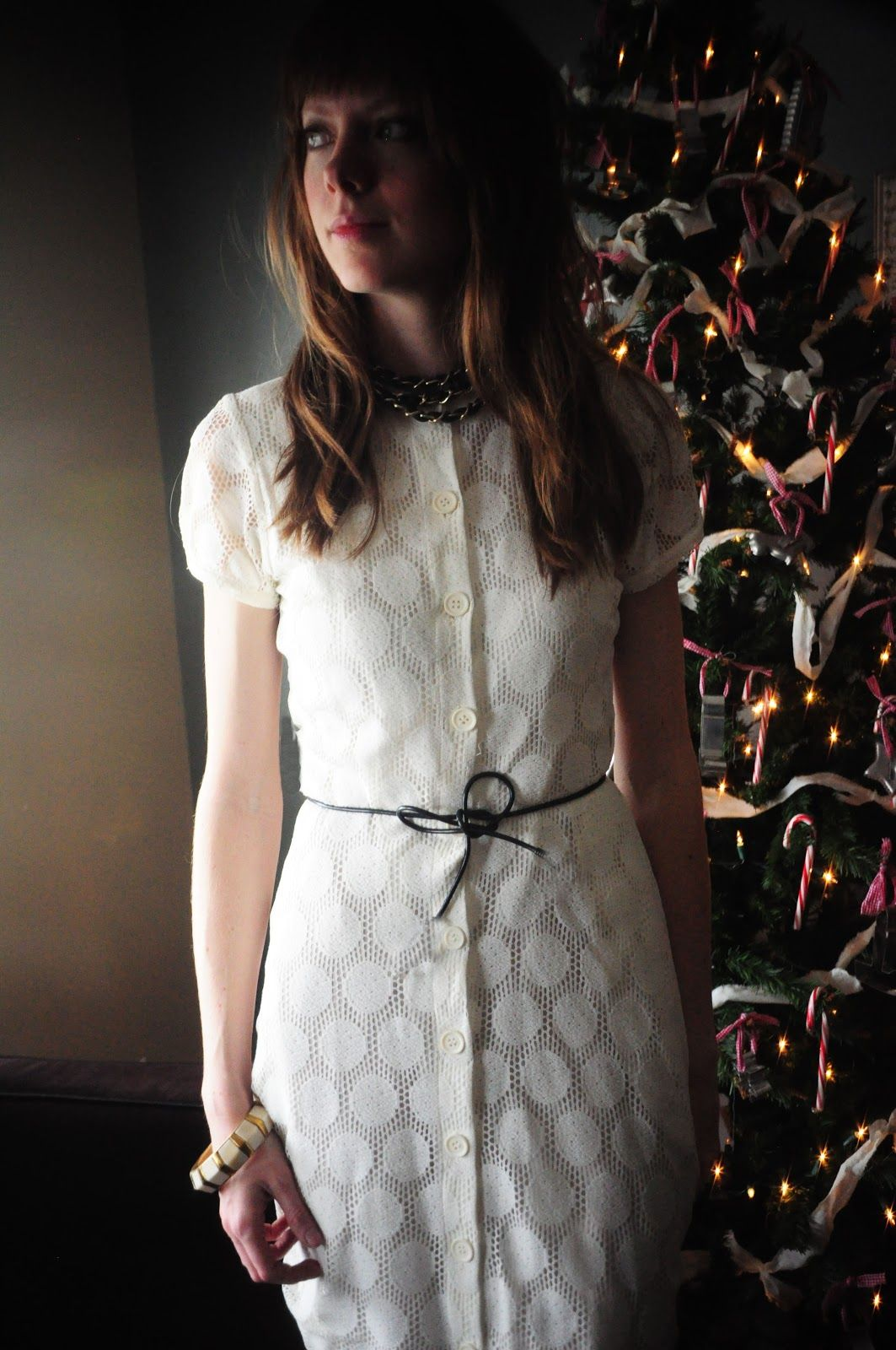 Holiday white dress with black cording bow belt