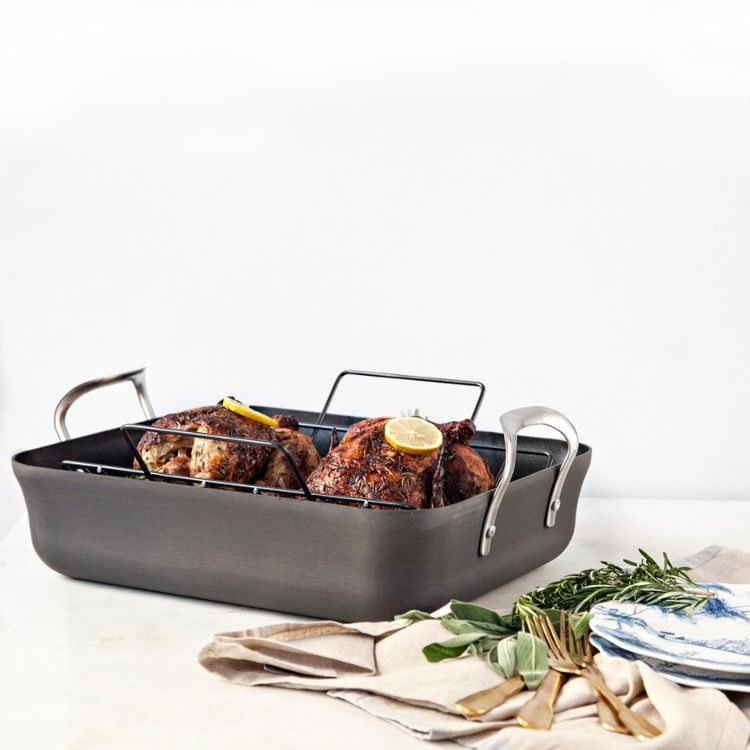 With a stunning contemporary design, Calphalon's roasting set is created with multi-layer, heavy-gauge nonstick aluminum for even heating and ultra durability. Perfectly sized to accommodate large turkeys, roasts, or hams, the double-riveted handles make lifting and turning easy. The nonstick rack elevates meat for even cooking and browning while lifting it away from fat, and because the roaster is both oven and stove safe, take the roaster directly from oven to stove top when it's time to…