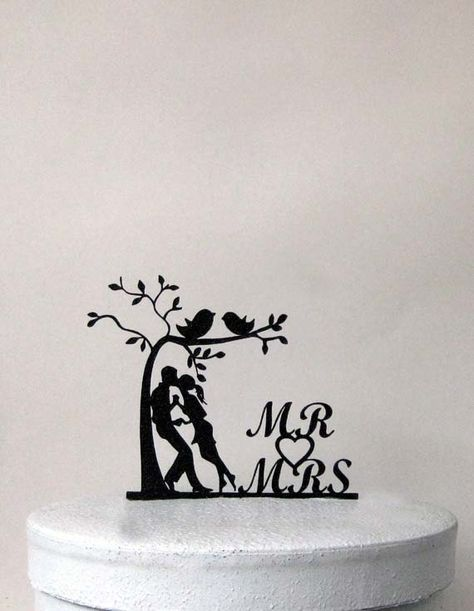 Bride and Groom Wedding Cake topper made of 1/8 black ABS plastic with non reflecting pebbled surface on the front and smooth back.  ABS silhouette