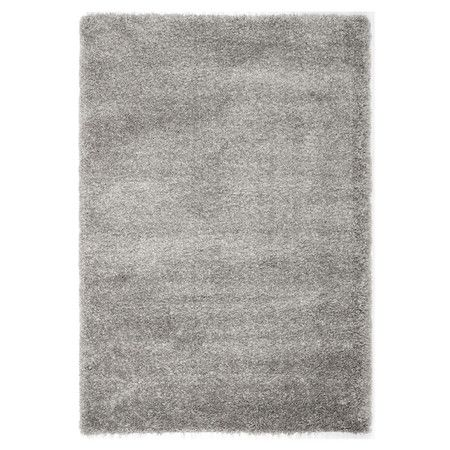 Bring textured appeal to your living room or master suite with this chic hand-tufted rug, featuring a silver shag design.  Product: ...