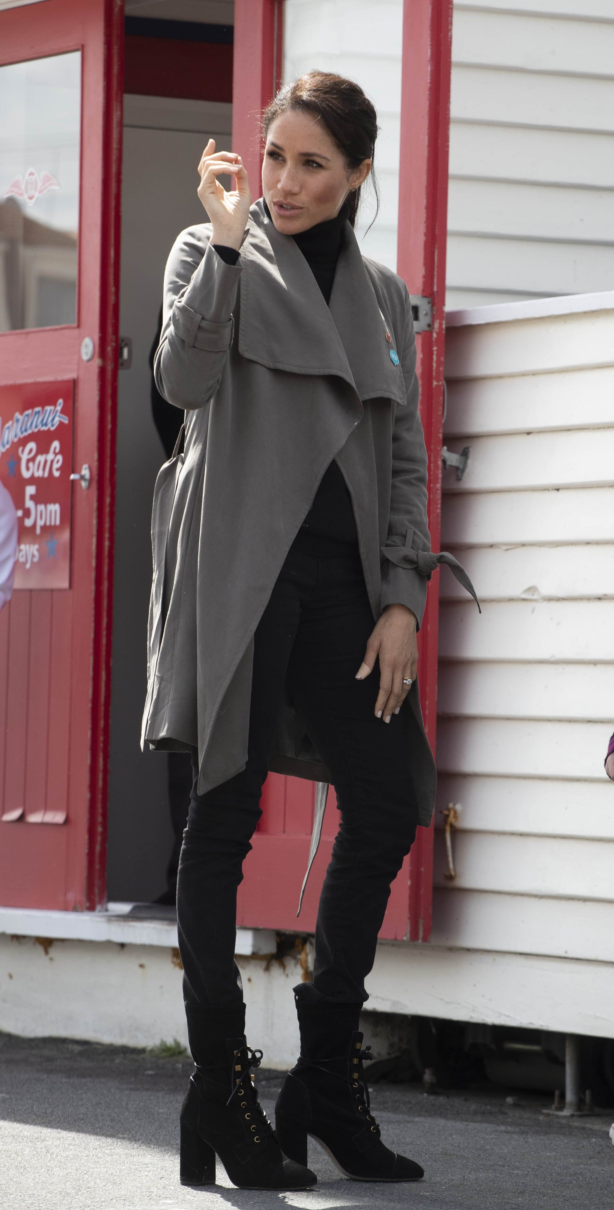 ce81d1a2828 Meghan Wore a Club Monaco Coat and Stuart Weitzman Boots For a Visit in New  Zealand