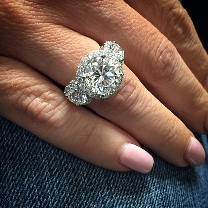 Diamonds Can Never Be Too Big With This Three Stone Triple Halo Ring