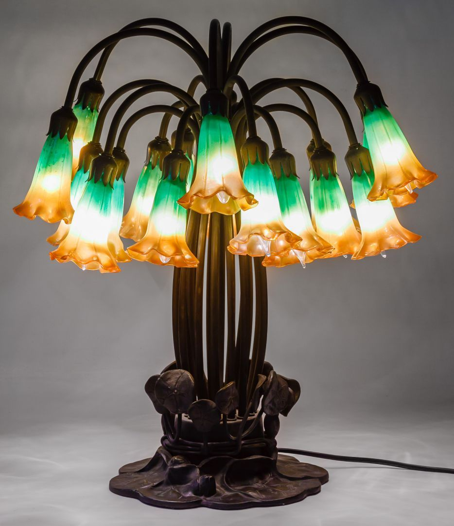 Lot 127 tiffany style tulip table lamp having eighteen iridescent lot 127 tiffany style tulip table lamp having eighteen iridescent gold to green floral aloadofball Images