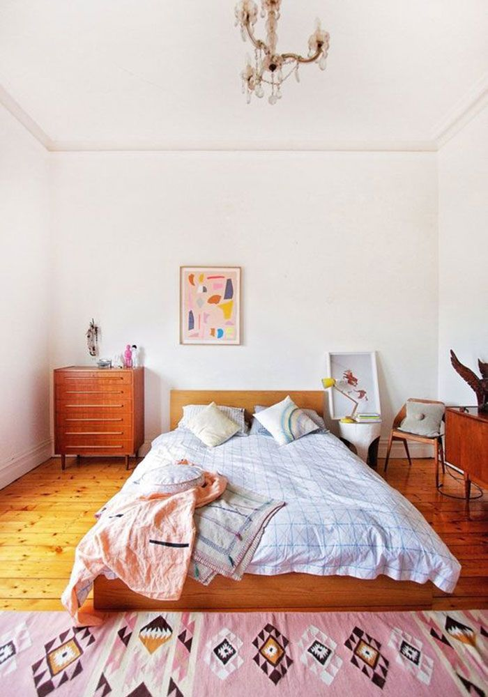 Bedroom With A Soft Pink Kilim Rug