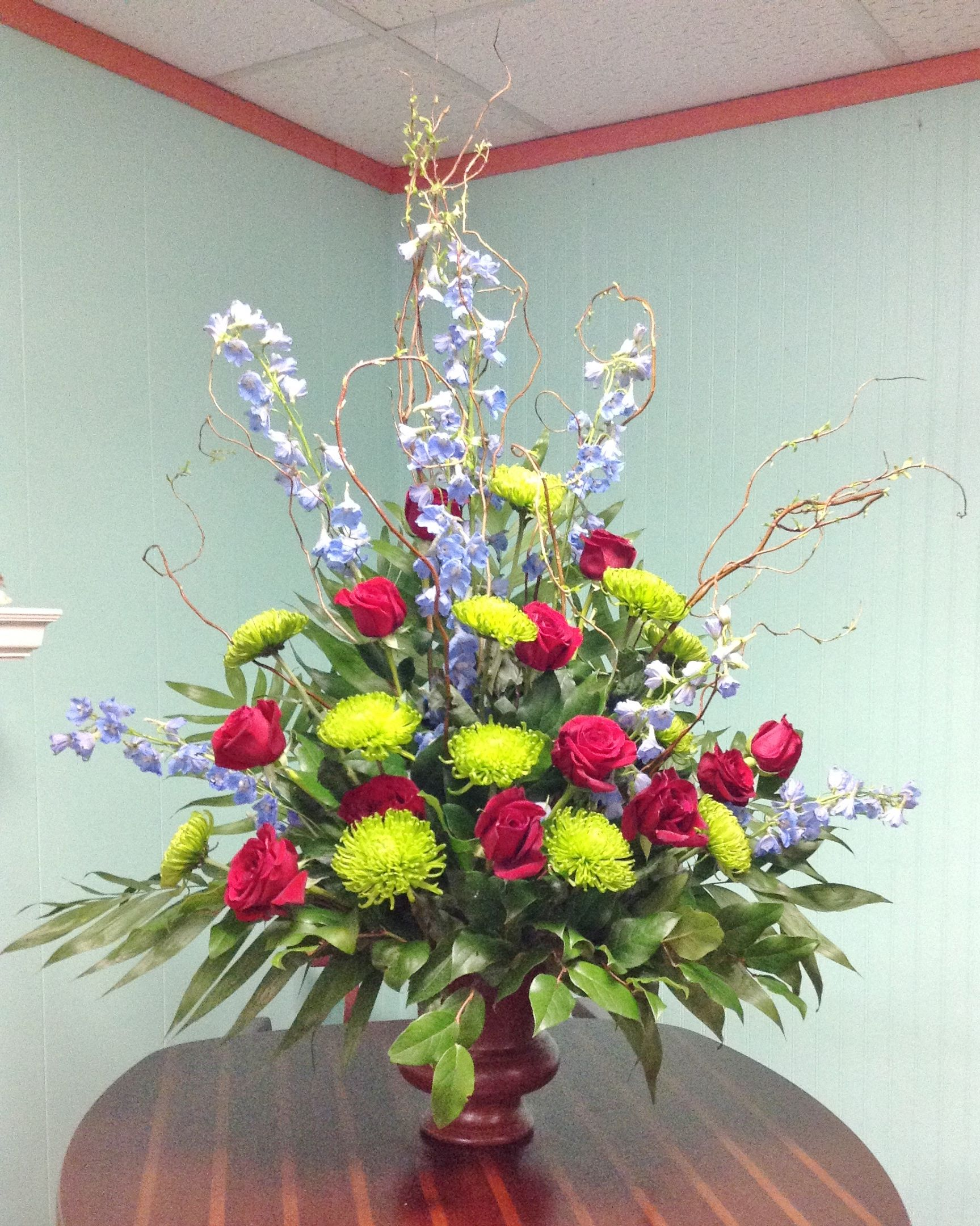 Large arrangement with blue red and yellow flowers sympathy large arrangement with blue red and yellow flowers mightylinksfo
