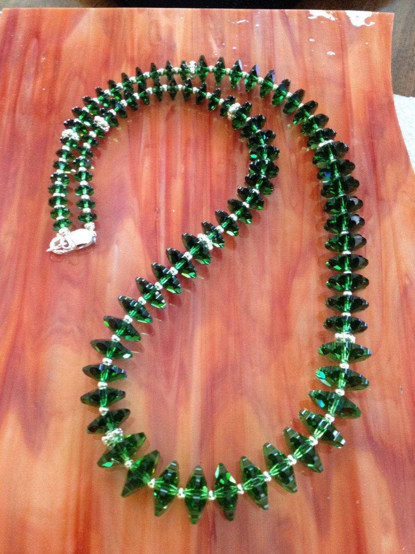 Green Swarovski Crystal, Sterling Silver Necklace (N16) by WindsweptGlass on Etsy https://www.etsy.com/listing/480563945/green-swarovski-crystal-sterling-silver