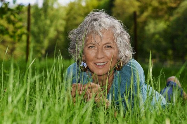 Middle-aged woman relaxing in the grass