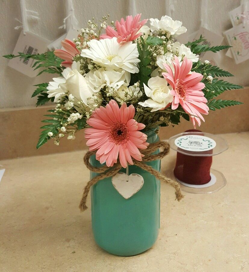 Mint or teal mason jar with pink and white gerberas
