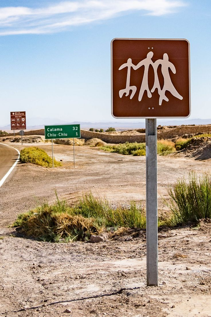 This road sign identifies petroglyphs in Chile. We spotted it as we were in Northern Chile looking for the ancient rock art. Check out the blog post to see a variety of interesting petroglyphs including some alien looking art.  #travel #Chile #petroglyph #rockart #southamerica #roadsign