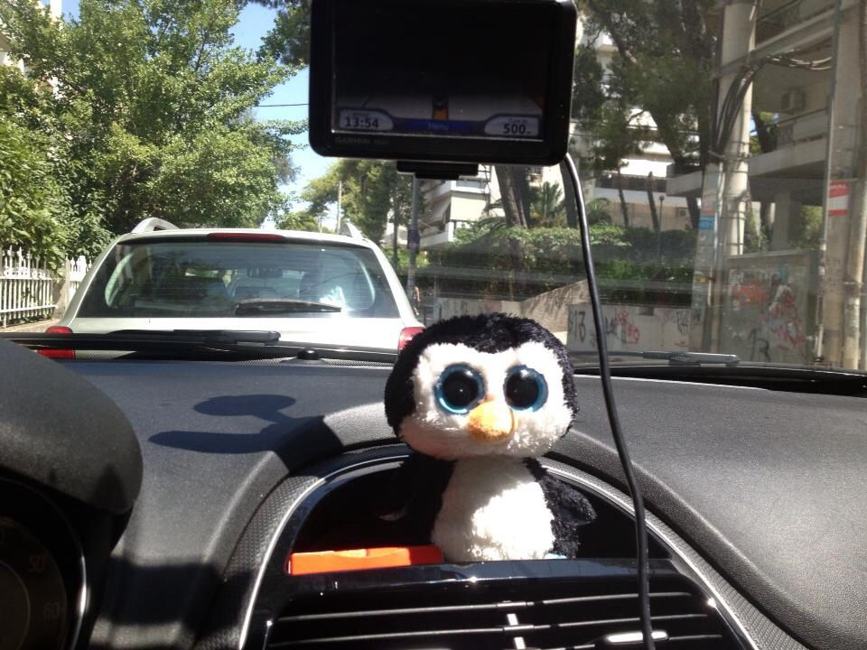 My little penguin in the Fiat Punto Grand in Athens, Greece. Kept me lots of company as I traveled around Greece in August 2013. <3