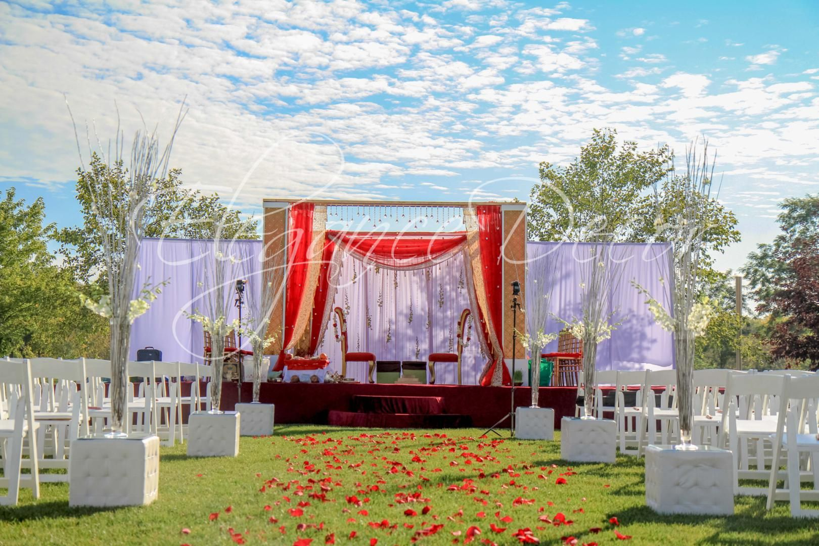 custom outdoor indian mandap ceremony with gold red white accents
