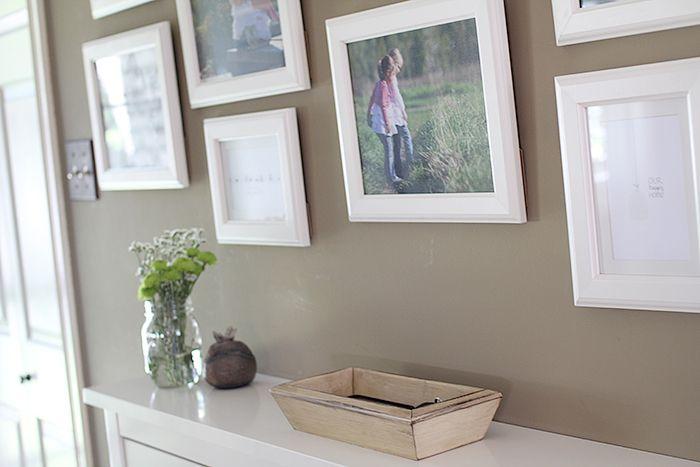 White Photo Frames On Beige Wall