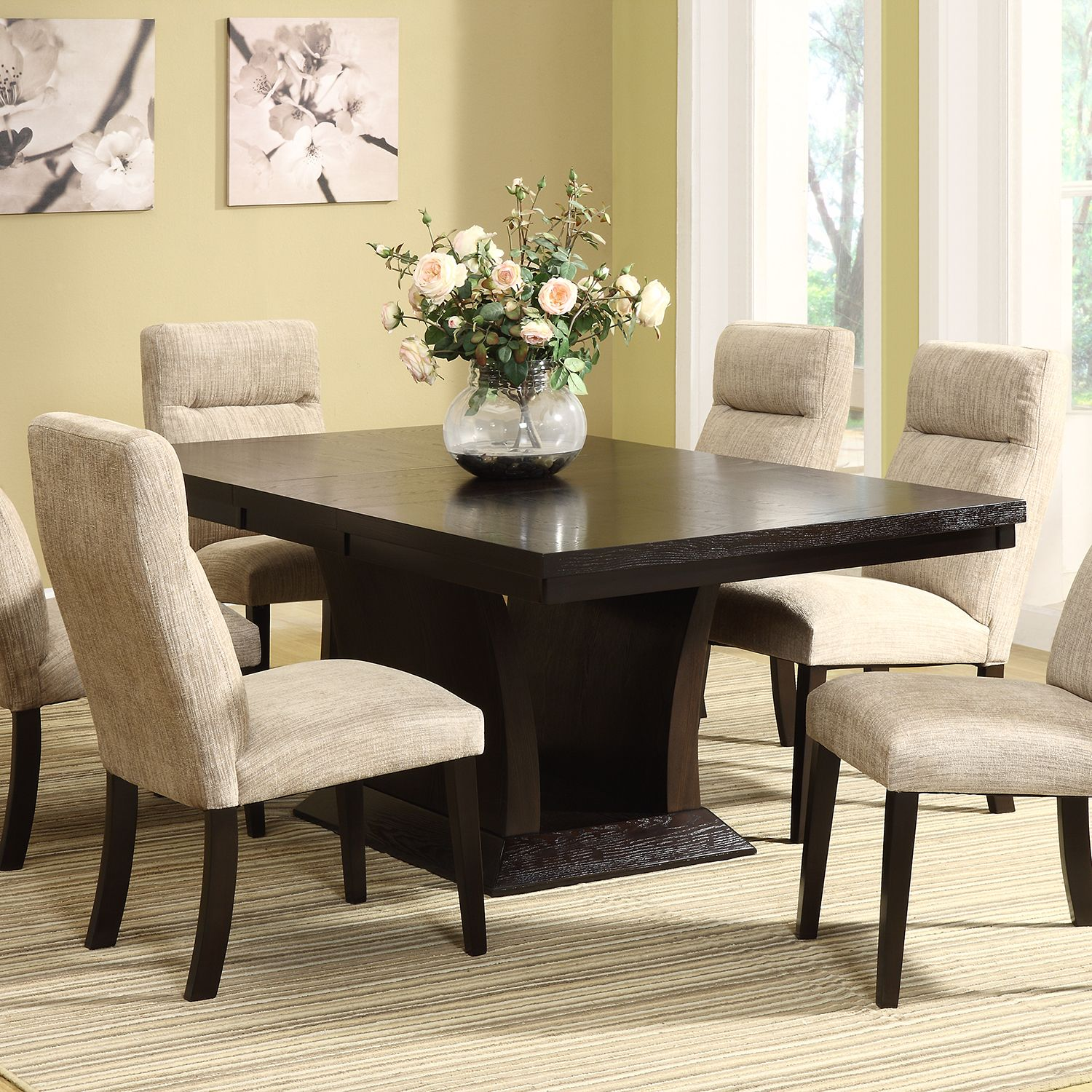 The Charles dining table from Tribecca Home comes with a butterfly  extension leaf, so you