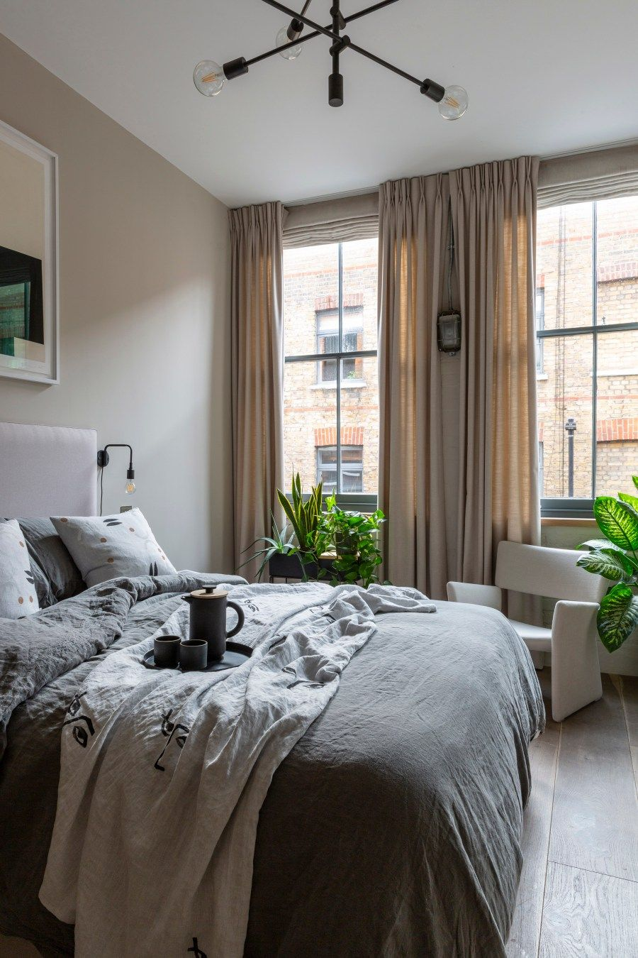 A Cosy, Beige Bedroom In A