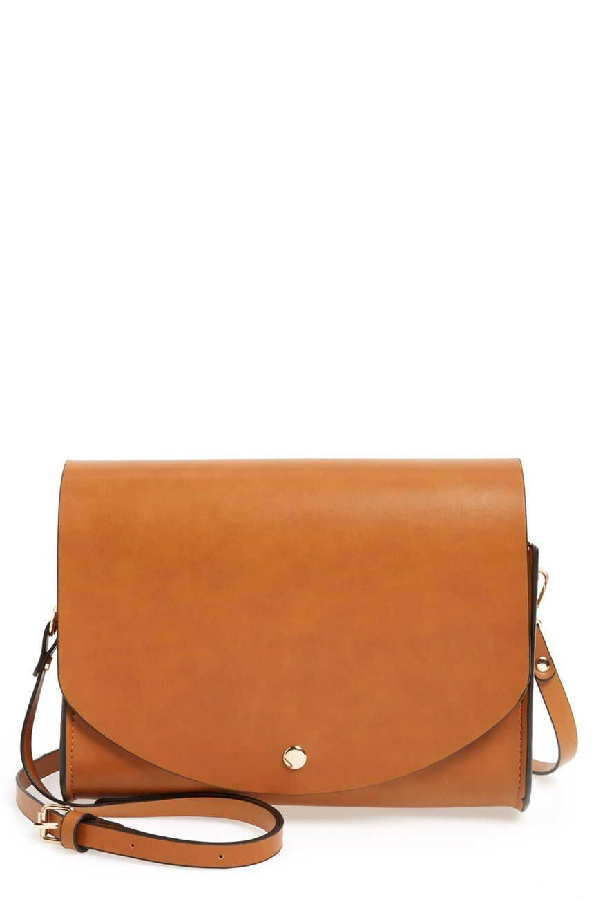A new favorite! Smooth and streamlined, this classic, faux-leather flap purse has a slim adjustable crossbody strap and minimalist styling.