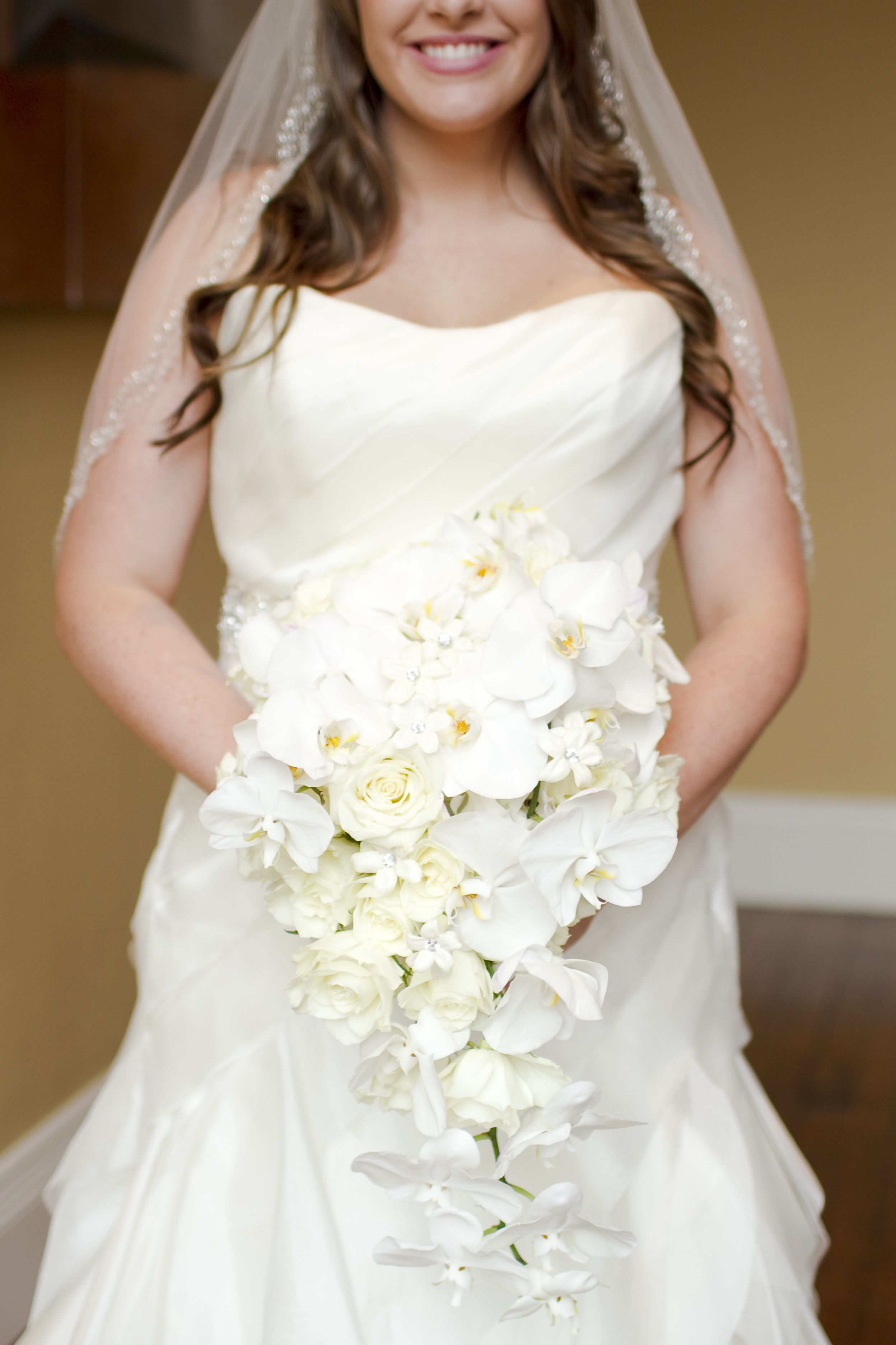 Cascade Orchid Bridal Bouquet : The bouquet will be a long narrow cascade of white