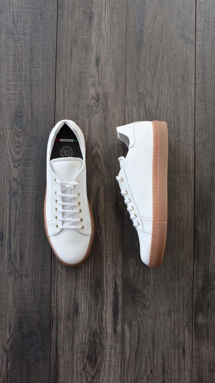 white leather sneakers with gum soles