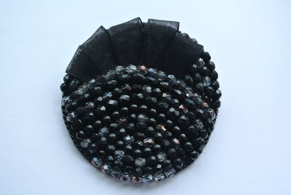 Very beautiful and unique bead embroidered brooch.    This Brooch decorated with bead embroidery technic.    The backside of the jewel has been covered in soft immitation leather.        Measure:  65mm    The color may look different, its because of the lighting in the photo.    Thanks for looking my shop