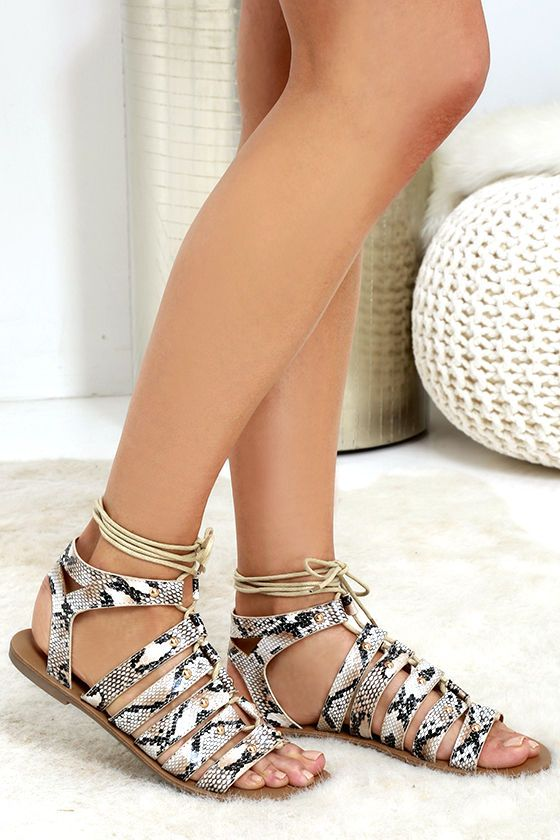 00964056acacbb Take it to the limits in the Outlying Lands Snake Print Lace-Up Flat Sandals!  These cute vegan leather sandals have a neutral snake print