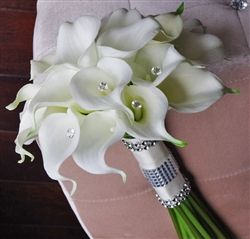 "wedideas.com	 Just so Delicate & Cute! Small Natural Touch Calla Lilies, the most realistic ones you will ever find, with your choice of 2 fillers and Crystal Accents. The crystals can be clear or colored and we can add additional bling details like rhinestones.   We can make this bouquet from a 6"" wide to a 12"" Wide. Size shown is 11"" and 7"" Wide. You can make further requests for custom details in our Special Requests Field. All custom requests will be confirmed on a separate email."