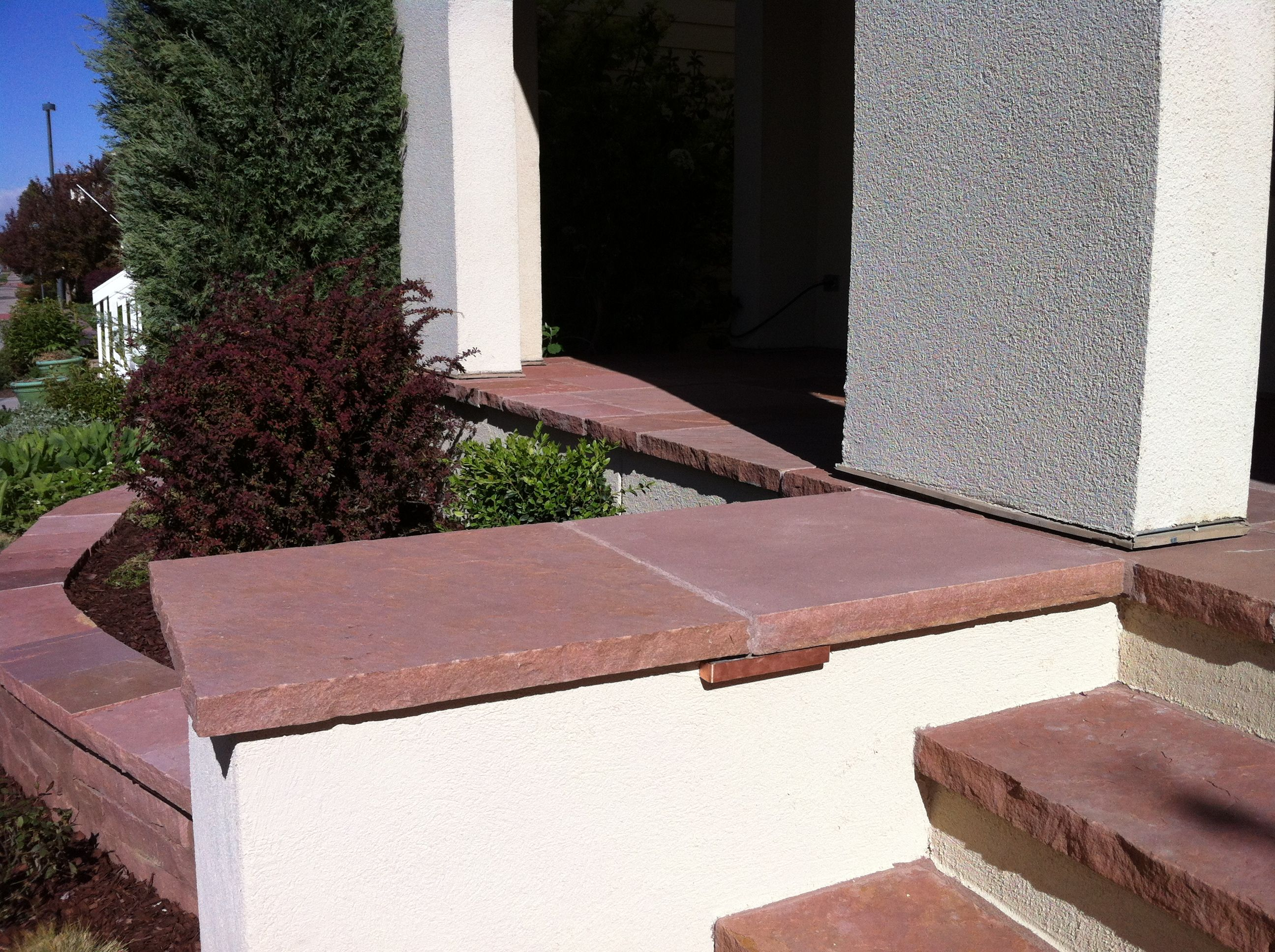 Stucco Wing Walls With Red Flagstone Caps And Copper Low