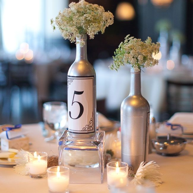 Painted wine bottle centerpieces silver spray painted Wine bottle wedding centerpieces