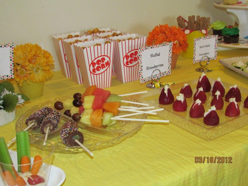 Caillou themed birthday party Food table with frozen bananas fruit