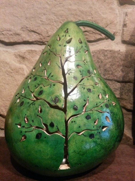 Hey, I found this really awesome Etsy listing at http://www.etsy.com/listing/161562522/hand-carved-gourd-tree-luminary