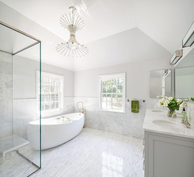 Master BathroomsWhite And Grey Bathroom Features A Metal Chandelier Adorned  With