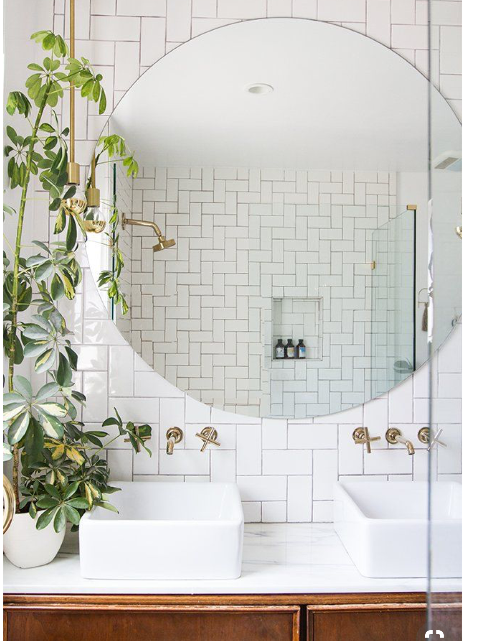 Pin by heather sneyd on interiors bathrooms pinterest bath beautiful double vanity with large round mirror brass fixtures and sconce white subway tile dailygadgetfo Image collections