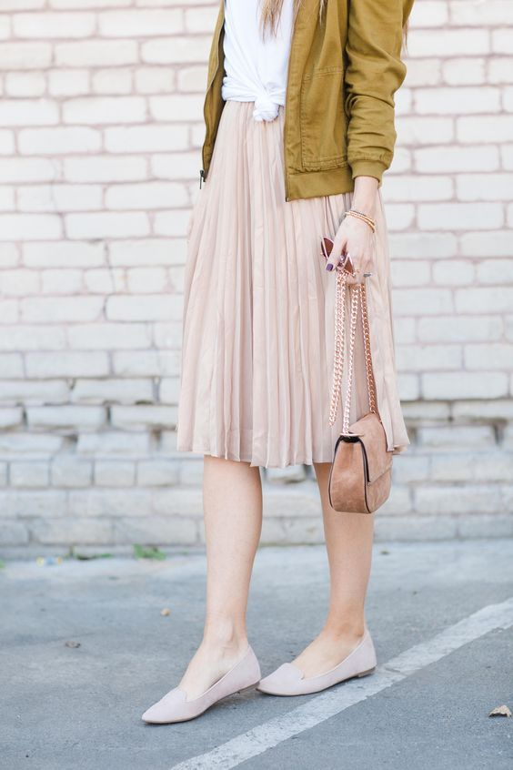 f6f9f18135 a blush pleated skirt and flats, a white tee and a mustard bomber ...